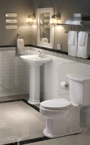 """Courtesy Mansfield Plumbing Products Bright white porcelain remains king when selecting a """"throne"""" for a powder room privy. Pictured here is Mansfield Plumbing's Barrett high-efficiency toilet."""