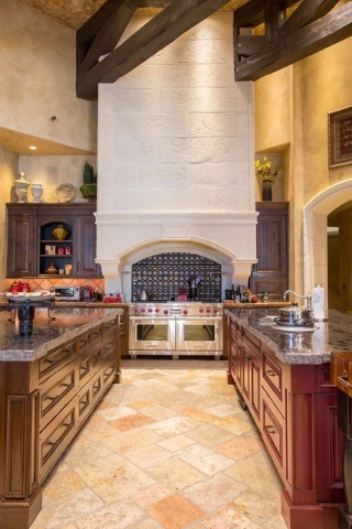 The main kitchen includes two granite-topped islands, breakfast bar, Subzero and Wolf appliances, handmade solid wood cabinets and a brick pizza oven. (Courtesy photo)