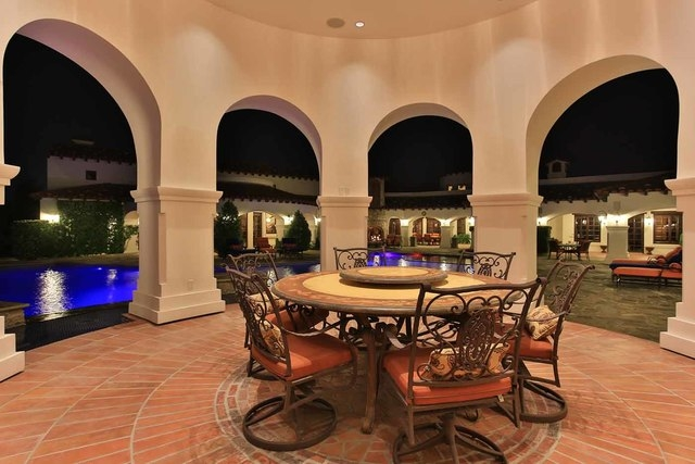 The home has an extensive outdoor kitchen that has a dining area and cabana.   (Courtesy photo)
