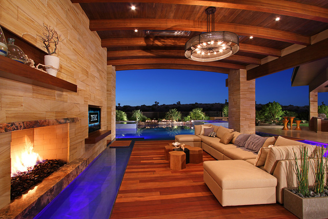 Sun West Custom Homes built his house in The Ridges with a pool that flows through the home.