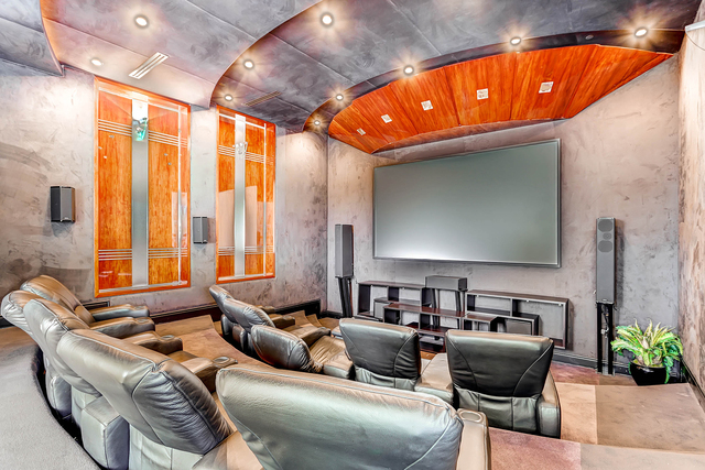 Courtesy photo  There has to be a theater to watch the games and movies for very sporty father. This Queensridge estate offers one for comfort and show.