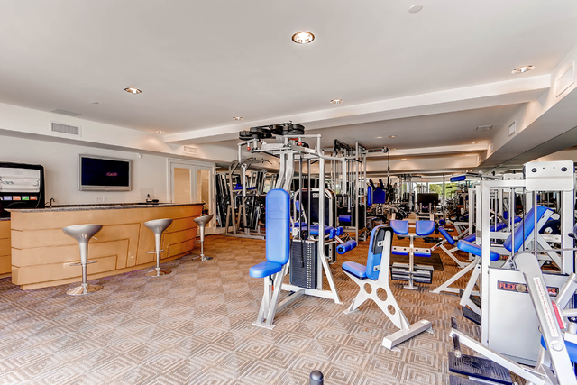Courtesy photo  Gyms are always good dad spaces. This Queensridge estate offers an upscale one.