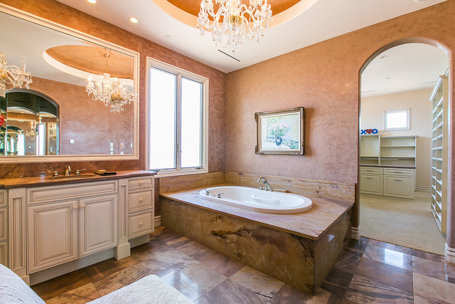 Courtesy photo The master bathroom has luxury amenities like a stone-lined tub, steam shower and his-and-hers separate toilet facilities including a bidet. It has handy access to a cavernous, shel ...