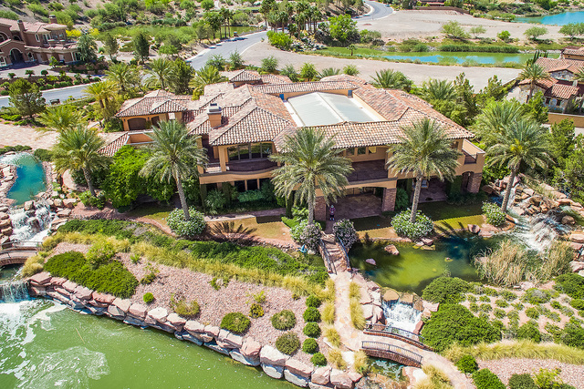 Courtesy photo  The Tuscan-inspired, 9,328-square-foot custom mansion is set in its own forest of palms, evergreen trees, flowering bushes and attractive wetland grasses. It is on the market for $ ...