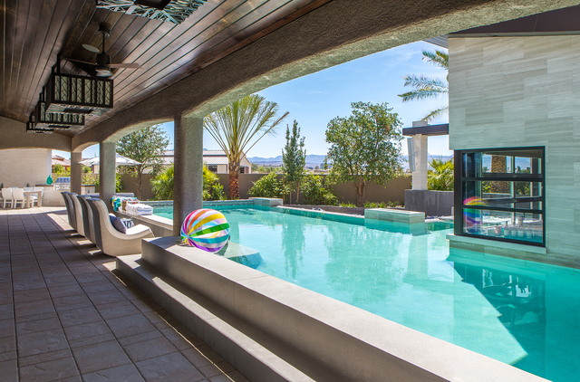 """Courtesy photo HGTV's """"Property Brother"""" stars, Drew and Jonathan Scott completed their pool area and water slide as part of one of their TV series, """"Property Brother's at Home."""""""