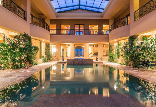 Courtesy photo  This two-story 9,328-square-foot Lake Las Vegas Southshore mansion features a 4,000-square-foot temperature-controlled atrium with a salt water pool. It is listed for nearly $10 mi ...