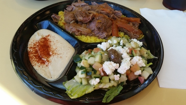 Lamb is is shown with hummus, feta salad and vegetable couscous at Crazy Pita at Downtown Summerlin, 10975 Sage Park Drive, No. 100. (Lisa Valentine/View)