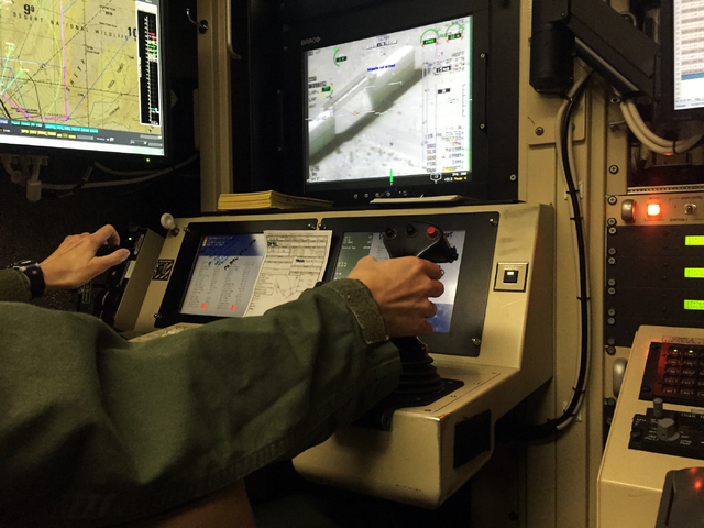 Capt. Kristi squeezes the trigger to launch a simulated laser-guided missile strike from an  MQ-1B Predator remotely piloted aircraft during a training sortie Tuesday, June 16, 2015, inside a grou ...