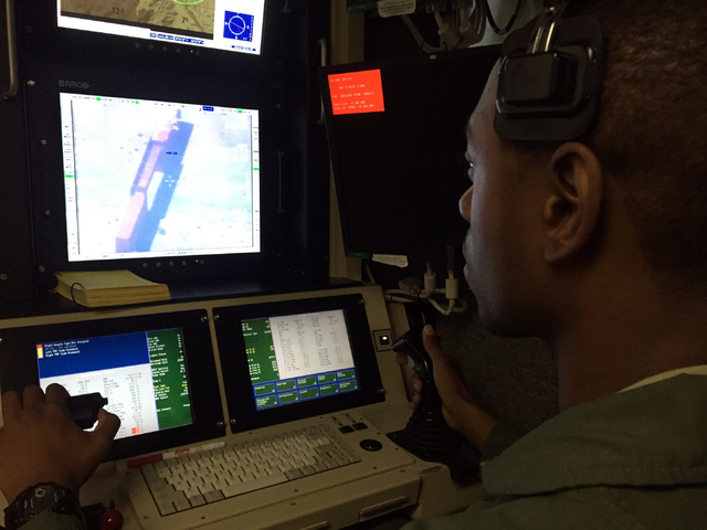 """Staff Sgt. """"J.J."""" Jerome maneuvers a stick to hold a laser beam on a target for a simulated missile strike by a MQ-1B Predator remotely piloted aircraft during a training sortie Tuesday, ..."""