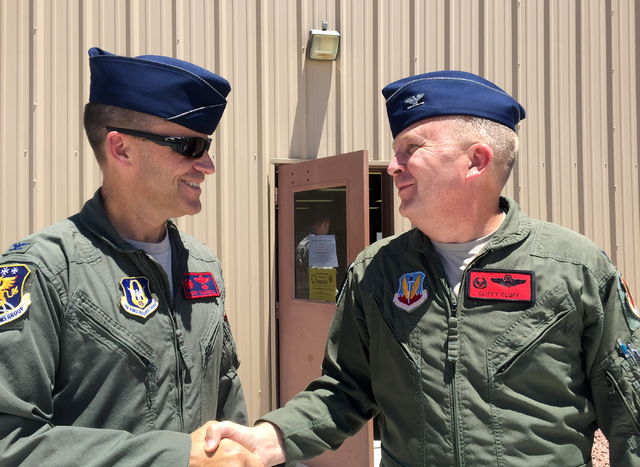 Col. Brent Caldwell, 726th Operations Group commander at Creech Air Force Base, left, shakes hands with Col. James Cluff, 432nd Wing commander, outside the base's Airmen Ministry Center on Tuesday ...