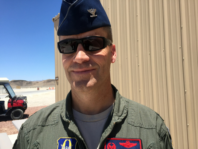 """Col. Brent Caldwell, 726th Operations Group commander at Creech Air Force Base, poses outside the base Airmen Ministry Center, Tuesday, June 16, 2015. """"We ensure that moms, dads, brothers and ..."""