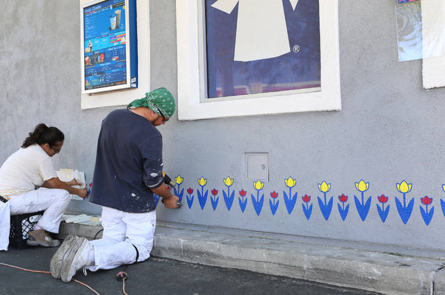 Gaudia Seal, left, and Juan Salazar, paint tulips on the wall at Dutch Bros. coffee shop at 2820 E. Tropicana Ave. Thursday, June 18, 2015. Dutch Bros. coffee shop, which has a 24-hour drive-thru, ...