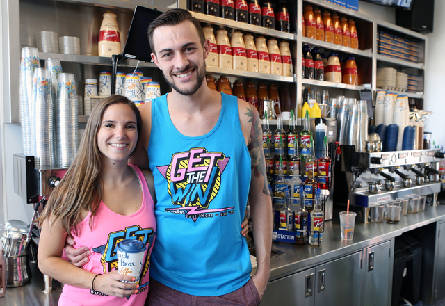 Dutch Bros. coffee shop co-owners, Kelli Gillespie, left, and her husband Cory Nimmer, pose for a photo at their coffee shop Thursday, June 18, 2015. Dutch Bros. coffee shop at 2820 E. Tropicana A ...