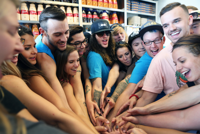 Dutch Bros. coffee shop co-owners, Kelli Gillespie, forth left, and her husband Cory Nimmer, third left, pose for a photo with their employees at their coffee shop Thursday, June 18, 2015. Dutch B ...