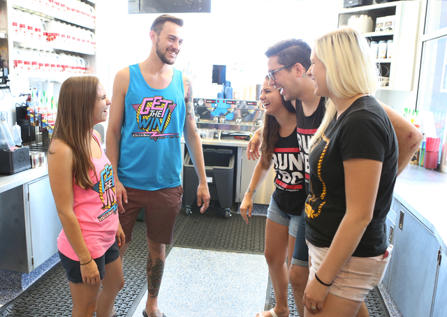 Dutch Bros. coffee shop co-owners, Kelli Gillespie, left, and her husband, Cory Nimmer, second left, talk to their employees, Maggie Bieber, right, David Trujillo, second right, and Cline Mackenzi ...