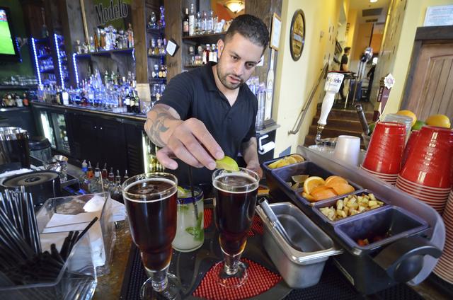 Omar Puerto tends bar at Sonrisa Grill in the Montelago Village at Lake Las Vegas in Henderson. (Bill Hughes/Las Vegas Review-Journal)