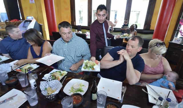 Ivan Cadena, standing, serves customers at the Sonrisa Grill. (Bill Hughes/Las Vegas Review-Journal)
