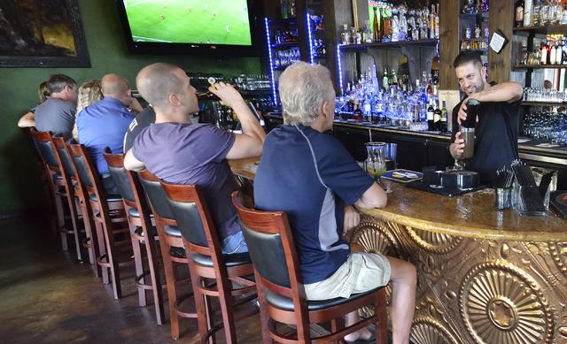 Omar Puerto tends bar at Sonrisa Grill at Montelago Village at Lake Las Vegas in Henderson. (Bill Hughes/Las Vegas Review-Journal)