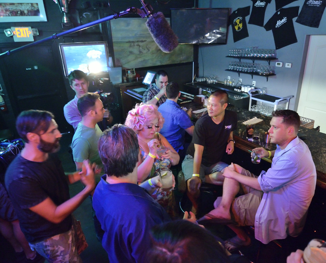 """Don Welch, right, and Zappos CEO Tony Hsieh, seated in black shirt, are shown prior to an interview with a camera crew from the Comedy Central show """"Drunk History"""" at Atomic Liquors at 9 ..."""
