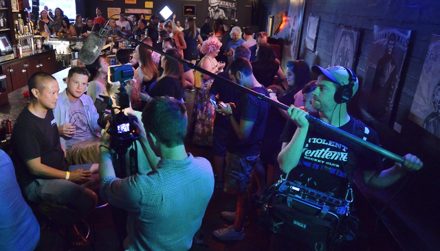 "Zappos CEO Tony Hsieh, left, and Don Welch are shown during an interview with a camera crew from the Comedy Central show ""Drunk History"" at Atomic Liquors at 917 Fremont St. on Saturday, ..."