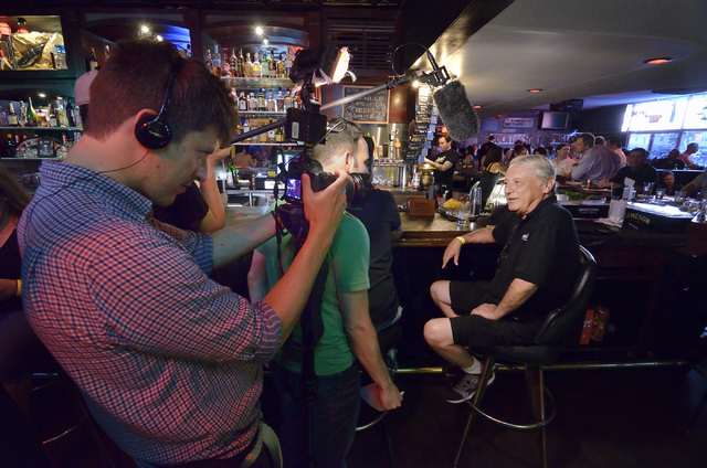 "Cameraman Tom Arsenault, left, films BJ Johnson, right, during an interview with a crew from the Comedy Central show ""Drunk History"" at Atomic Liquors at 917 Fremont St. on Saturday, Jun ..."