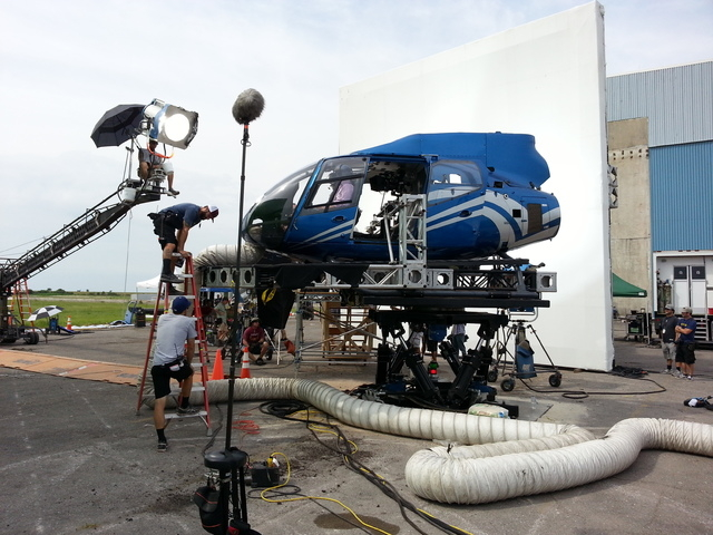 """A film crew prepares to shoot a scene using a helicopter mockup from Las Vegas-based Scroggins Aviation in this undated photo from the set of """"Jurassic World."""" (Courtesy/Scroggins Aviation)"""