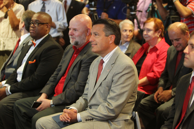 Governor Brian Sandoval listens to UNLV President Len Jessup at UNLV on Thursday, June 10, 2015, in Las Vegas. The bill provides funds for UNLV's law, medical, business and hotel schools. (James T ...