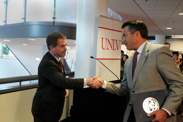 UNLV President Len Jessup, left, shakes hands with Governor Brian Sandoval at UNLV on Thursday, June 10, 2015, in Las Vegas. The bill provides funds for UNLV's law, medical, business and hotel sch ...