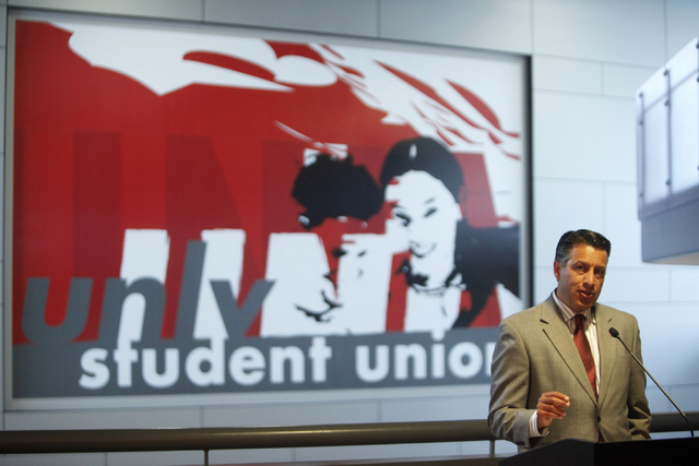 Governor Brian Sandoval speaks to bill signing attendees at UNLV on Thursday, June 10, 2015, in Las Vegas. The bill provides funds for UNLV's law, medical, business and hotel schools. (James Tensu ...