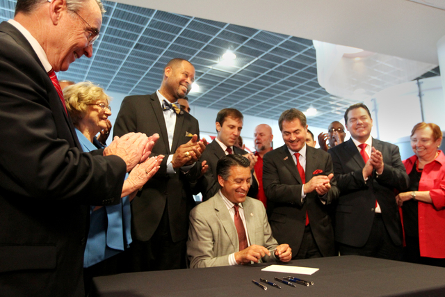 Governor Brian Sandoval signs Bill SP 514 at UNLV on Thursday, June 10, 2015, in Las Vegas. The bill provides funds for UNLV's law, medical, business and hotel schools. (James Tensuan/Las Vegas-Re ...