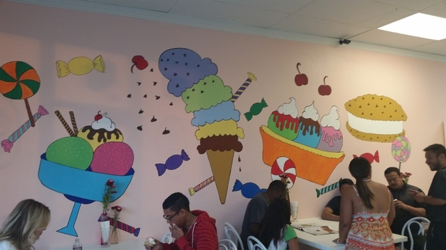 Patrons enjoy cool treats in front of a wall painted with cartoon desserts at Eis Cream Cafe, 9711 S. Eastern Ave., Suite H-1, in Henderson June 6, 2015. The ice cream shop, which offers exotic fl ...