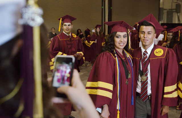 Sandra Acevedo, left, takes a picture of Kenia Hernandez, center, and Bryan