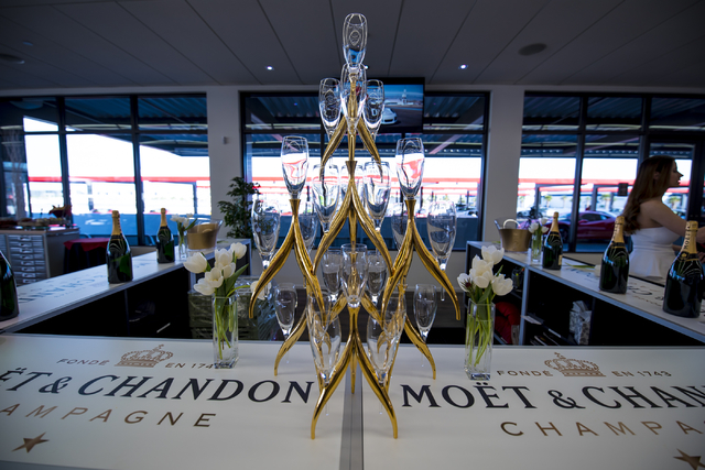 A tower of champagne glasses highlights one of the sponsors at the grand opening of Exotics Racing's new welcome center at Las Vegas Motor Speedway in Las Vegas on Thursday, June 4, 2015. (Joshua  ...