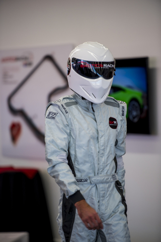 A masked driver entertains invited guest as they tour the new welcome center at Exotics Racing during the grand opening at Las Vegas Motor Speedway in Las Vegas on Thursday, June 4, 2015. (Joshua  ...