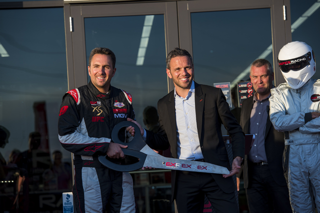 From left, Romain Thievin and David Perisset, founders of Exotics Racing, cut the ribbon at Exotics Racing during the grand opening at Las Vegas Motor Speedway in Las Vegas on June 4, 2015. (Joshu ...
