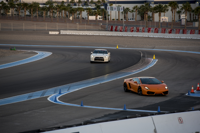 Invited guests receive rides in luxury sports cars at Exotics Racing during the grand opening of the new welcome center at Las Vegas Motor Speedway in Las Vegas on Thursday, June 4, 2015. (Joshua  ...