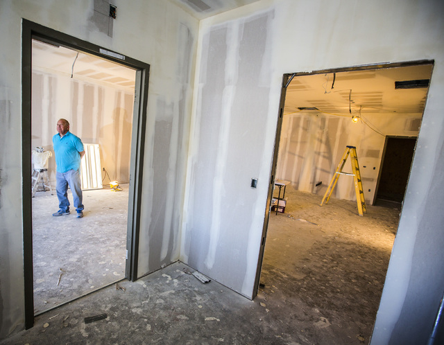 Joe Lamarca, one of the owners of Euphoria Wellness, 7780 S. Jones Boulevard, is seen Friday, Jan. 9,2015 inside the site of the under construction medical marijuana dispensary. Euphoria Wellness  ...