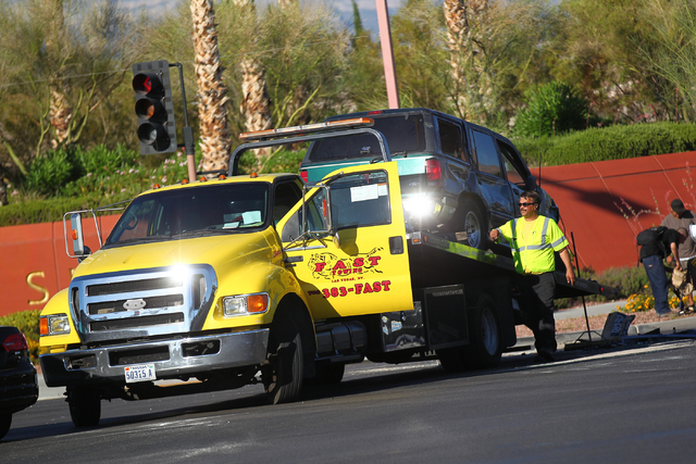 Las Vegas police respond to a rollover accident at Flamingo Road and Hualapai Way in Las Vegas on Wednesday, June 17, 2015. (Chase Stevens/Las Vegas Review-Journal)