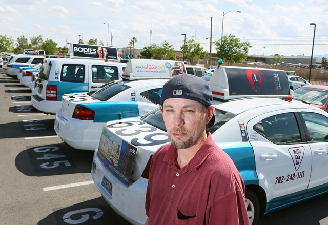 Taxi cab driver Greg Janz stands outside parked cabs at Nellis Cab Co. headquarters, located at 5490 Cameron St., Tuesday, May 26, 2015, in Las Vegas. Last April, Janz turned in a media case that  ...