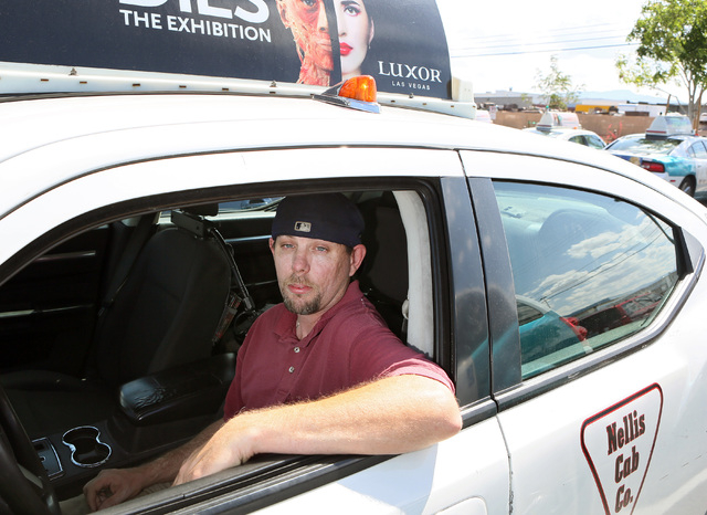 Taxi cab driver Greg Janz sits in a cab at Nellis Cab Co. headquarters, located at 5490 Cameron St., Tuesday, May 26, 2015, in Las Vegas. Last April, Janz turned in a media case that was left behi ...