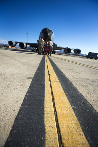Airmen from the  91st Air Refueling Squadron from MacDill AFB gather around  a KC-135 Stratotanker Wednesday, June 10, 2015 at Nellis Air Force Base. The squad participated in Green Flag-West. Fol ...