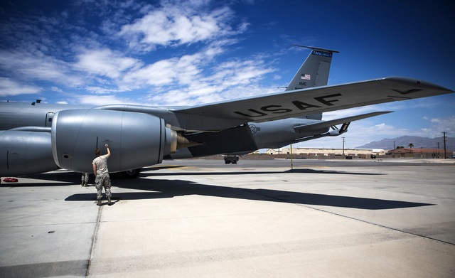 An airman from the 91st Air Refueling Squadron from MacDill AFB does a post flight check on a KC-135 Stratotanker Wednesday, June 10, 2015 at Nellis Air Force Base. The squad participated in Green ...