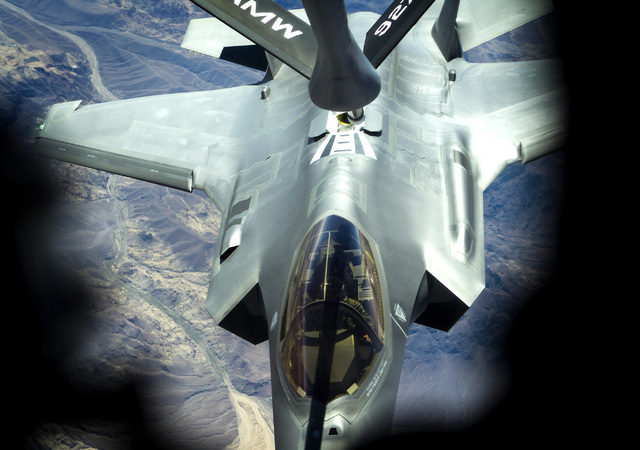 A F-35 Lightning II from the 31st Test and Evaluation Squadron during a refueling exercise over Fort Irwin,Cal. on Wednesday, June 10,2015. This was the first public refueling of the air force's n ...