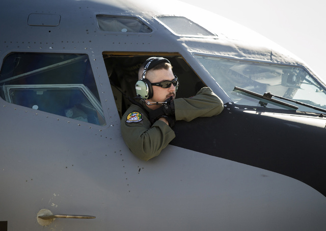 1st L. Ryan Merrifield from the 91st Air Refueling Squadron leans out the cockpit of a KC-135 Stratotanker before take off at Nellis Air Force Base on Wednesday, June 10, 2015. The squad from MacD ...