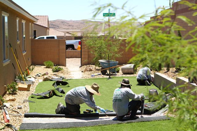 artificial grass las vegas. Jose Armenta, Left, And Pedro Armenta Work On Installing Artificial Turf At A Home Grass Las Vegas