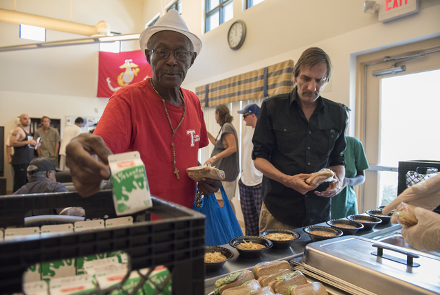 U.S. Army veteran Richard Nathaniel Walker Jr., left, grabs lunch sponsored by non-profit organization HELP USA at the Genesis apartments in Las Vegas on Thursday, June 25, 2015. (Martin S. Fuente ...