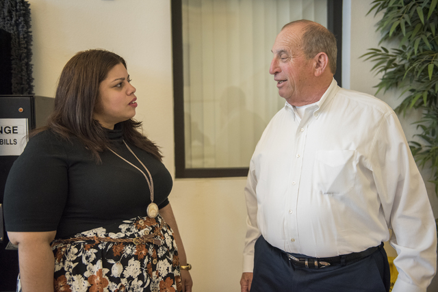 Supportive Service for Veteran Families Program Director Adina Archibold, left, and Regional Director for non-profit organization HELP USA Steve Silverman, talk at the Genesis apartments in Las Ve ...