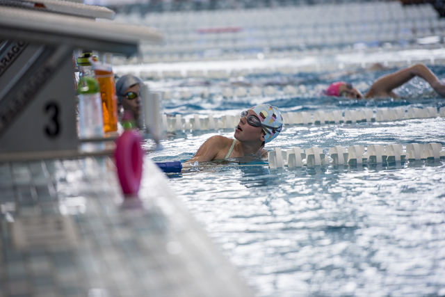 Emma Foster, 11, looks up at her coach during team practice at the Heritage Park Aquatic Complex, 310 S. Racetrack Rd., in Henderson on Thursday, June 11, 2015. (Joshua Dahl/Las Vegas Review-Journal)