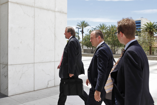 Las Vegas attorney Keith Gregory, left enters the Lloyd D. George U.S. Courthouse on Wednesday, June 17, 2015, in Las Vegas. Gregory and other defendants were sentenced in the scheme to take over  ...