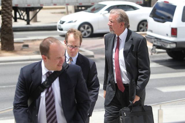 Las Vegas attorney Keith Gregory, right, enters the Lloyd D. George U.S. Courthouse on Wednesday, June 17, 2015, in Las Vegas. Gregory and other defendants were sentenced in the  scheme to take ov ...